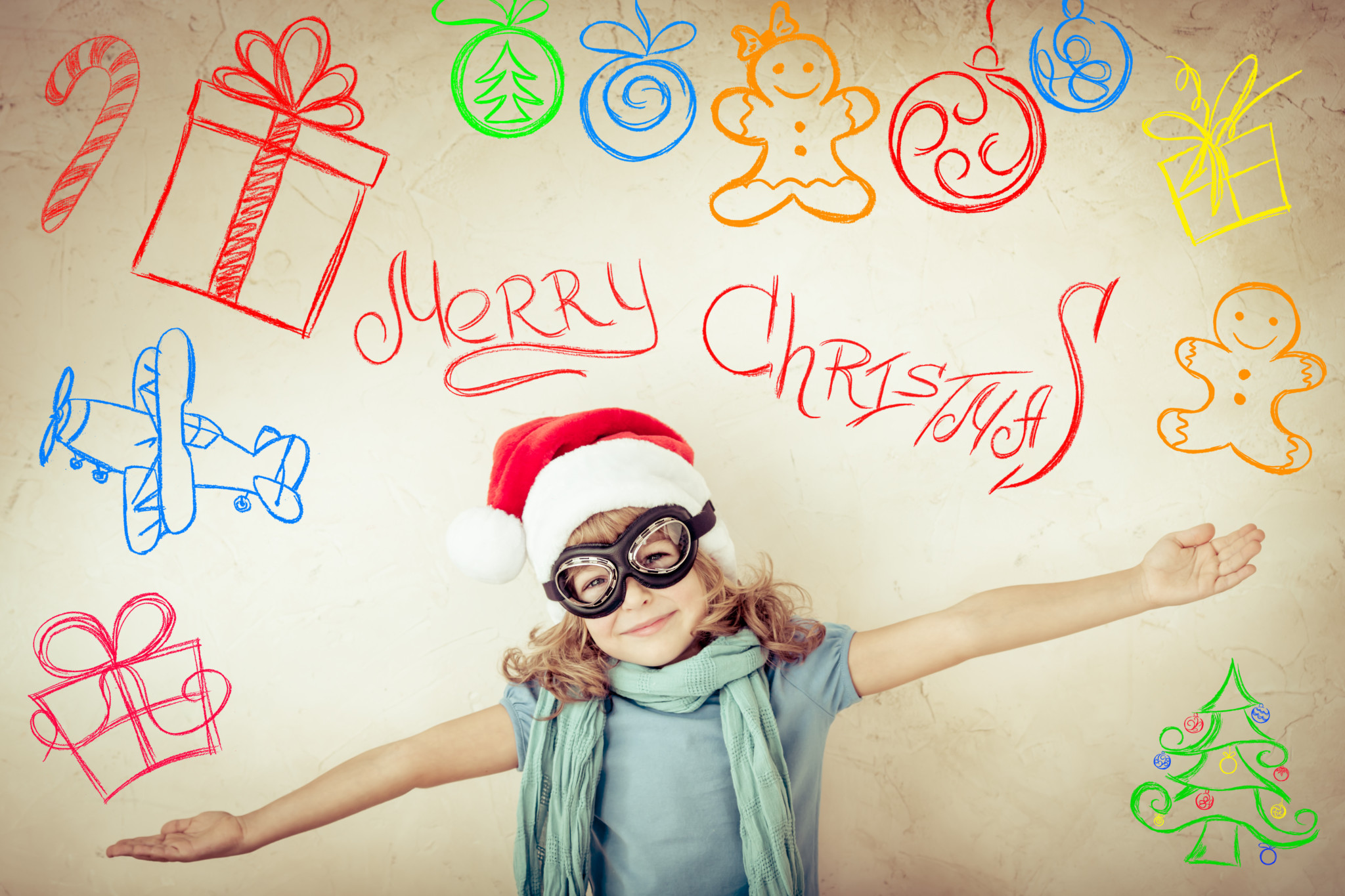 Christmas background with child with googles pretending to be fllying