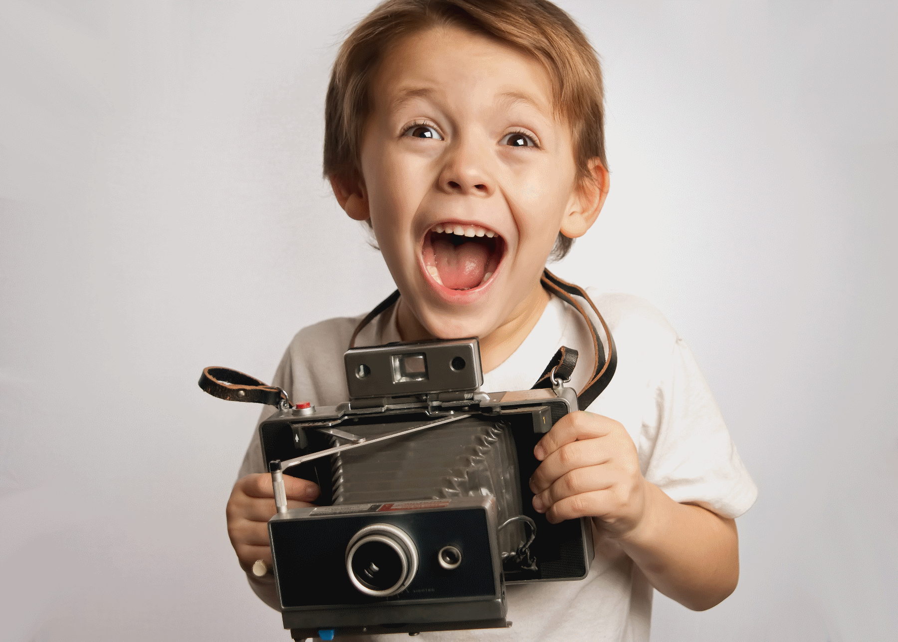 small child with camera with laughing face